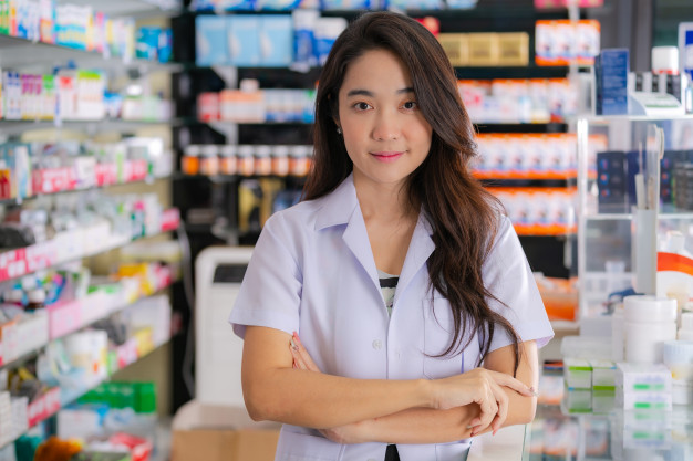 a female pharmacist stand in pharmacy store