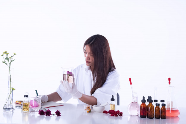 a female biotechnology student working in lab