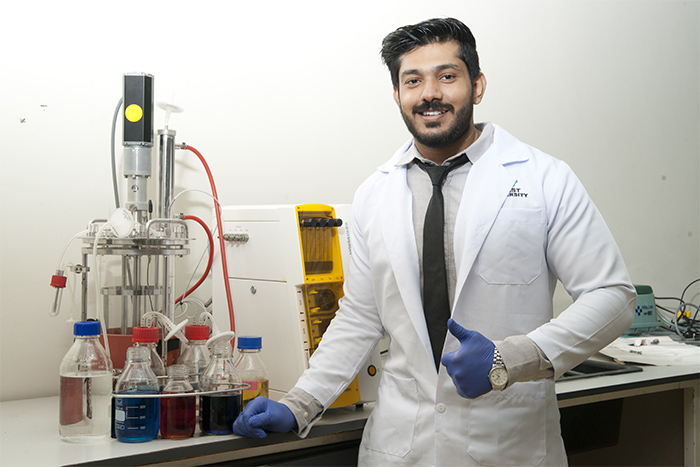 a male Medical Biochemistry student in lab