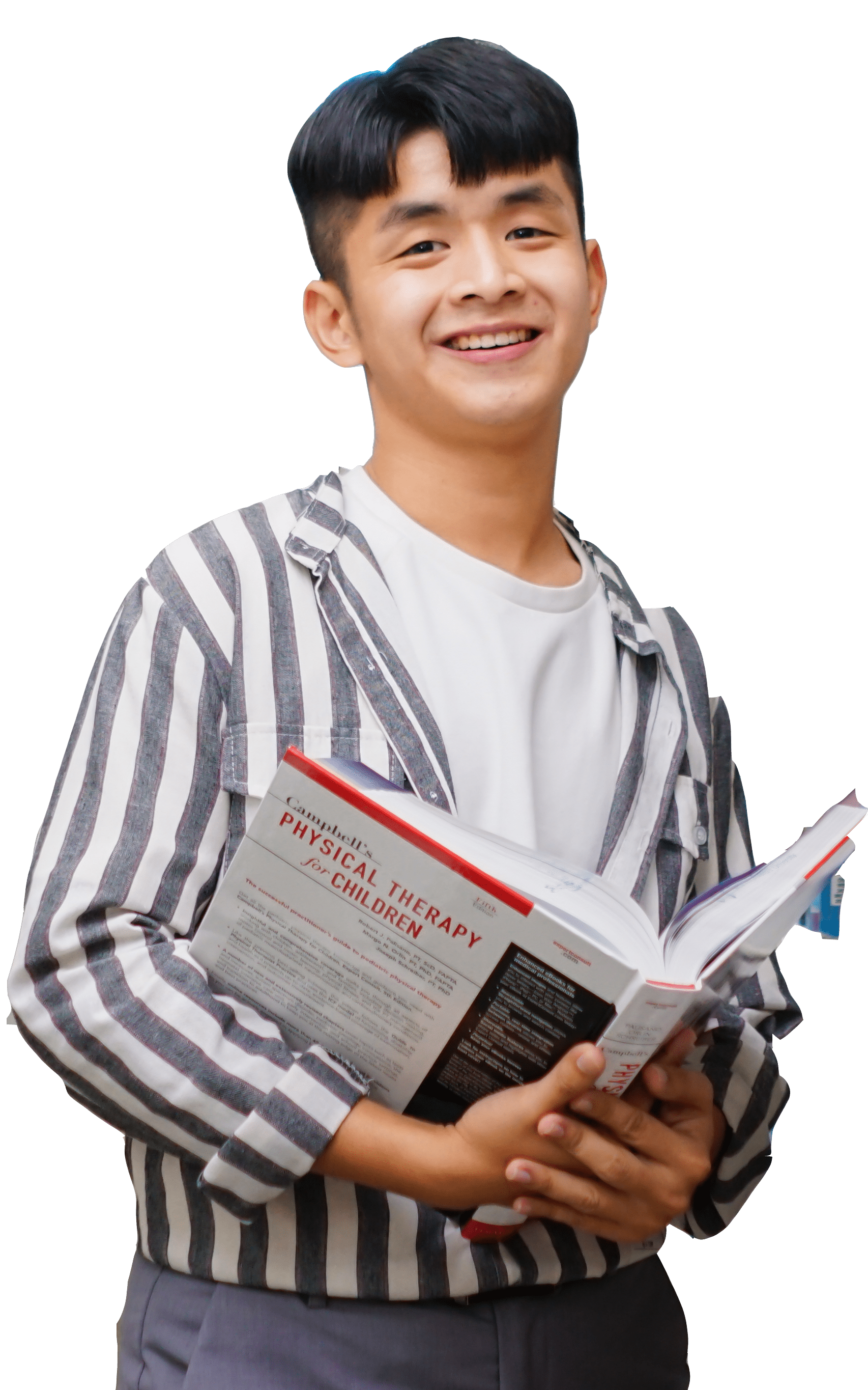 an Asian student standing and holding a book