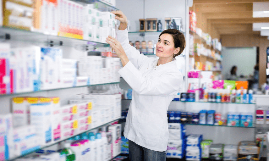 a female pharmacist arranging stock