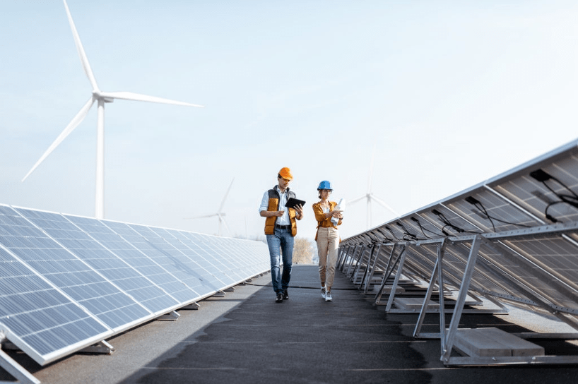 one female and male doing inspection at solar panels plants