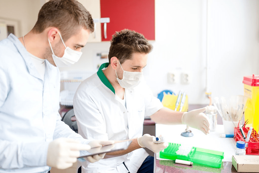 two white male lab assistants working in lab