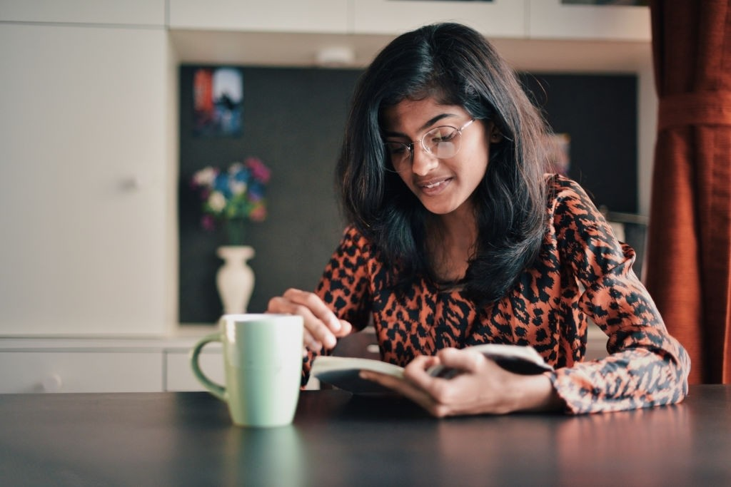 an Indian girl is reading a book