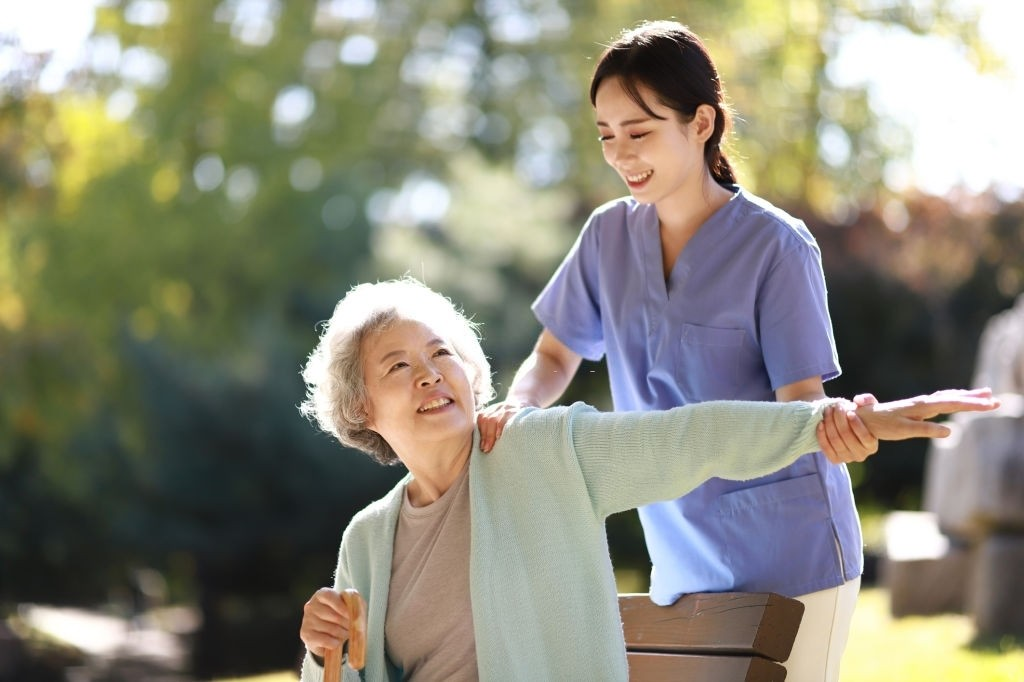 Senior woman exercising with a female physiotherapist