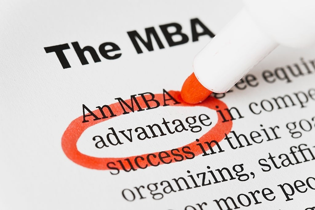 Red pen circles advantage in document headed MBA