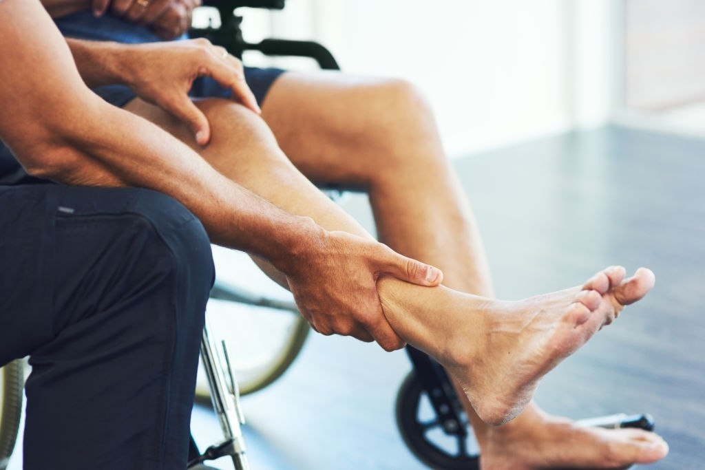 male physiotherapist assisting a senior patient in recovery