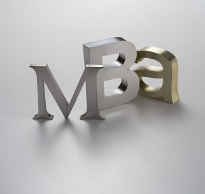 MBA - Master of Business Administration. Metal letters in soft diffuse light.