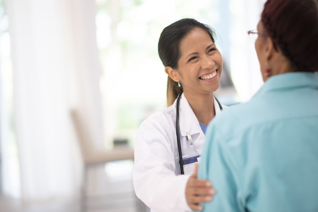 female doctor smiling with a patient